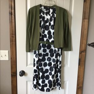 Black and white dress with green shrug/belt